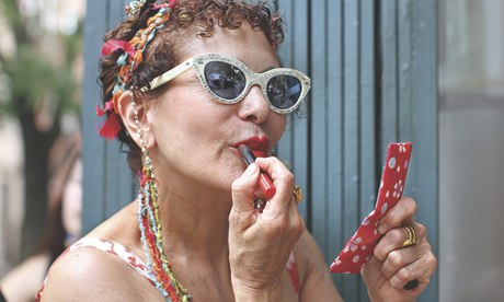 Woman putting on lipstick, Humans of New York