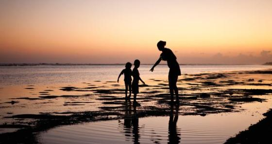 mother with kids at beach