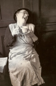 woman laughing with coffee