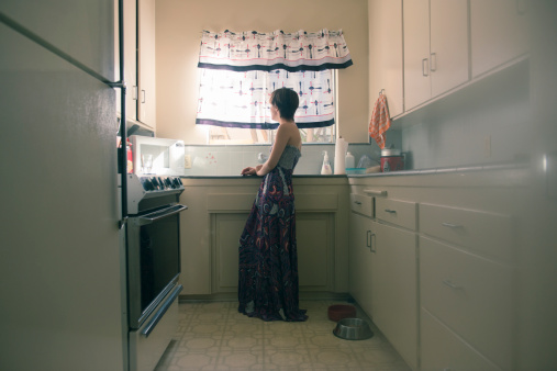 woman in kitchen alone