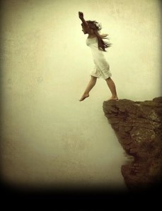 girl stepping off cliff