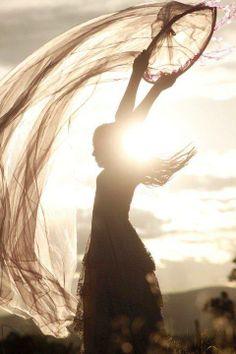 woman dancing in sunshine