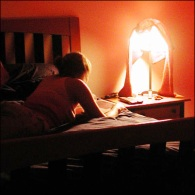 woman_writing_diary_on_bed