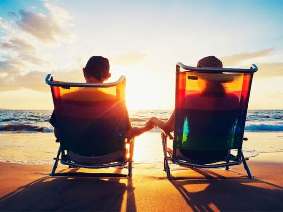 couple in separate beach chairs