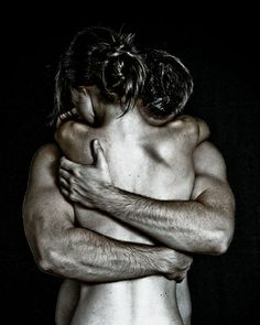 man holding woman arms