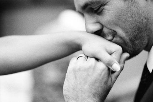 man kissing womans hand