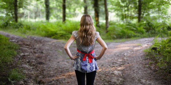 woman in woods deciding
